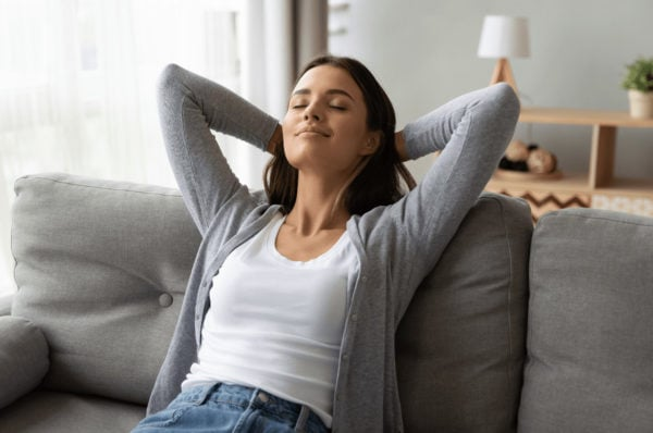 Woman relaxing in air conditioned home