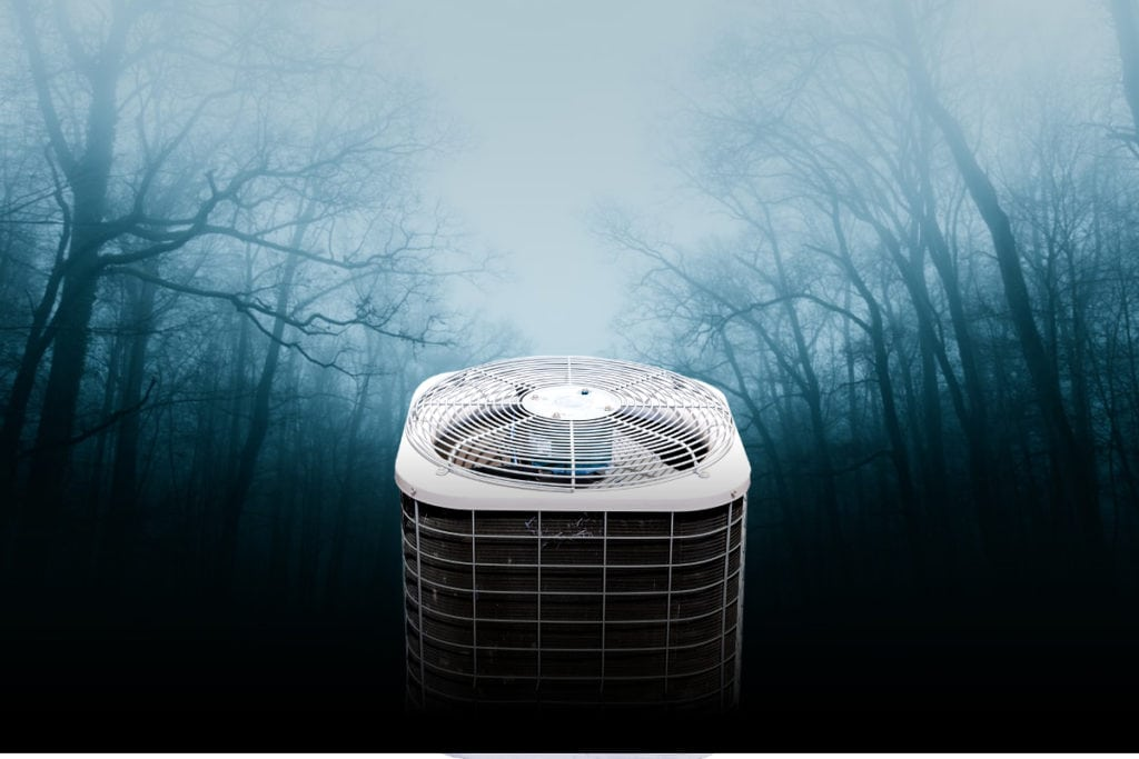 Air conditioner unit in a foggy wooded area